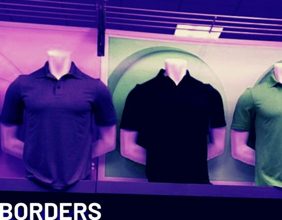 mannequins wearing polo shirts in a store display