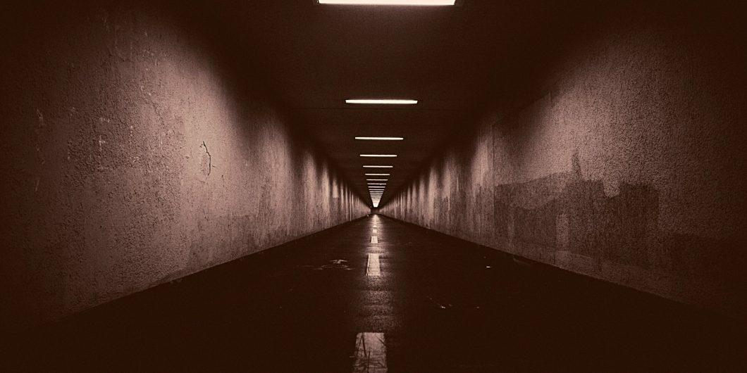 dark tunnel with light seeping in