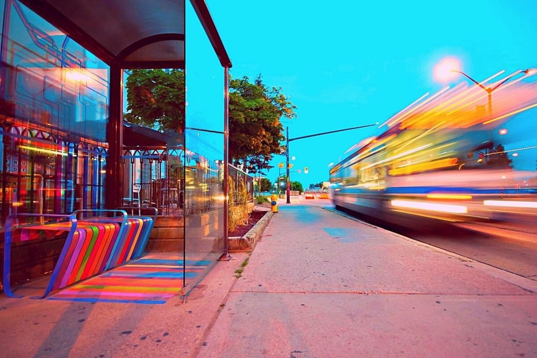 brightly colored transit center with blurred train passing by