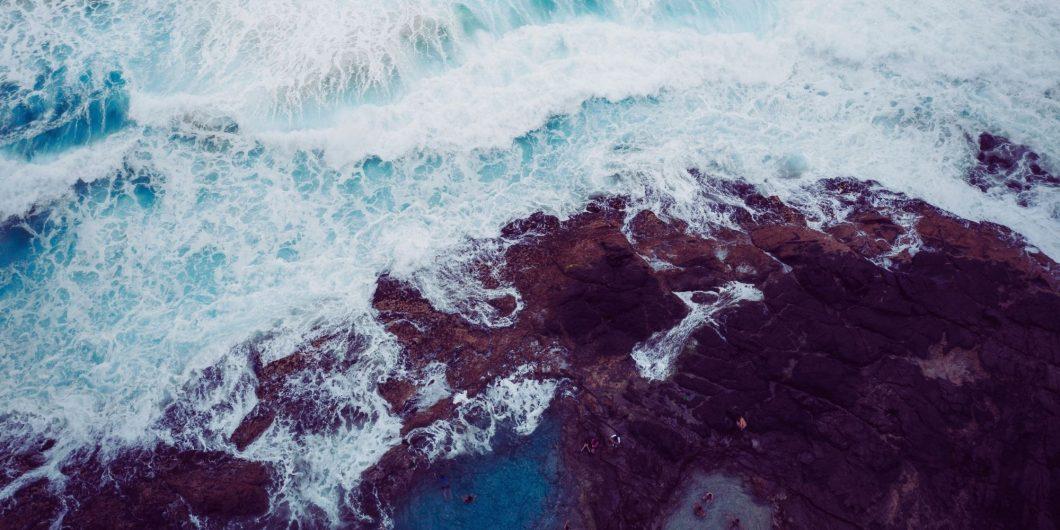 rough waves crashing onto rocks